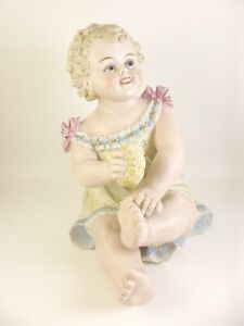 Antique German Bisque Porcelain Piano Baby Figurine Item A7