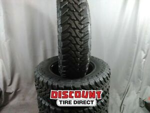 4 Used Lt275 70r R18 125p B Toy Open Country M t Tires