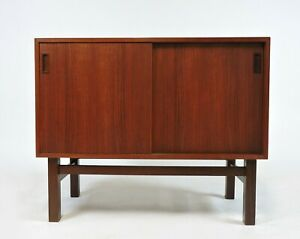 Danish Modern Small Teak And Rosewood Sliding Door Credenza Cabinet 1960s