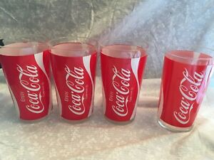 set of 4 Coca-cola glasses. Enjoy Trade-mark on three. red with white ribbon