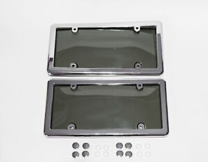 2 Tinted Smoke License Plate Shield Covers 2 Chrome Frames 8 Caps Brand New