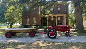 Farmall B Tractor rare With Two Steering Wheels And Matching Hay Wagon