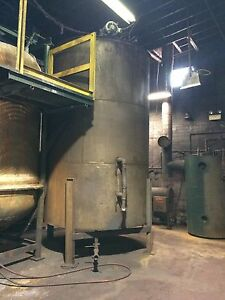 12141 005 Used Approximately 4000 Gallon Vertical Stainless Steel Tank