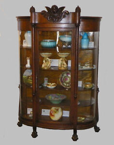 Antique Oak China Curio Cabinet With Carved Cherub In The Crest
