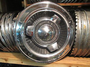 One 1965 Dodge Coronet 14 Inch Spinner Hubcap Wheel Cover