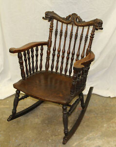 Antique Victorian Oak Rocking Chair With Spindles Carved Dolphin