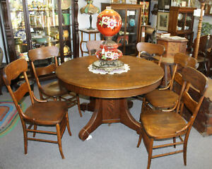 Antique Round Quarter Sawn Oak Dining Table With Two Leaves