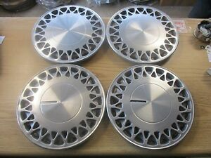 Factory Plymouth Acclaim Voyager Caravan 14 Inch Metal Hubcaps Wheel Covers Set