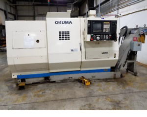 Used Okuma Lu 15 Cnc Lathe 8 Chuck 2 Bar 2 Turrets Chip Conveyor Osp 5020l