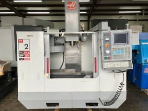 Used Haas Vf 2d Cnc Vertical Mill 2002 Tsc Fourth Axis Int Auger Prog Cool Auger