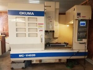 Used Okuma Mc v4020 Cnc Vertical Mill 2004 Osp e100l 15000 Rpm Tsc Chip 20 Tools