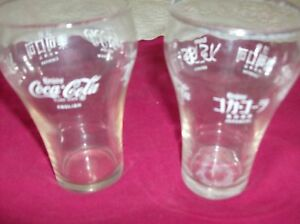 2 Coca Cola Glasses & Different Countries Spelling