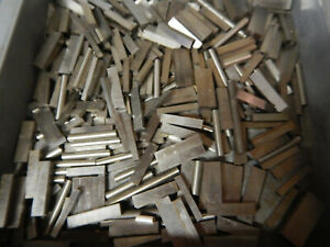 Pile Of Small Metal Pieces From A Gage Gauge Block Pin Gage Grinding Shop