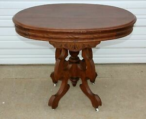 Antique Victorian Walnut Wood Oval Carved Parlor Table Finial Porcelain Casters