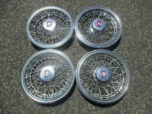 1986 Oldsmobile Cutlass Supreme 14 Inch Metal Wire Spoke Hubcaps Wheel Covers