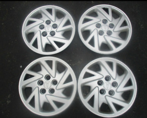 Factory 2000 To 2005 Pontiac Sunfire Bolt On 14 Inch Hubcaps Wheel Covers