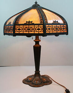 Antique 2 Socket Slag Glass Panel Lamp With A Brown Colored Base