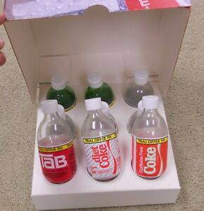 Set Of 9 1980's Trial Size Coca Cola Bottles Cherry Coke Glass  10oz Display box