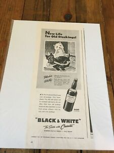 Vintage 1943 Black & White Whiskey Scottie Dogs Playing With Old Stockings ad