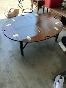 Old Wooden Coffee Table With Folding Sides That Has Brass Hindges