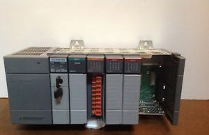 Allen Bradley 7 slot Rack With Power Supply And 5 Cards 1746 a7 Slc 500