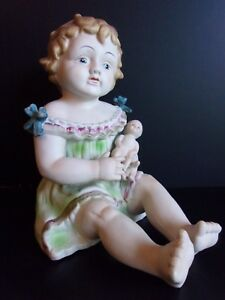 Vintage Porcelain Piano Baby Girl Holding Doll