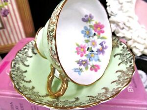 Rosina Tea Cup And Saucer Lime Green Gold Gilt Floral Blossoms Inside Teacup