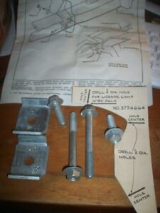 Nos 1957 Chevrolet Rear Bumper Guard Brackets Instalation Hardware 3734643