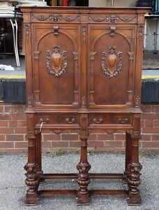 Antique Carved Walnut Spanish Renaissance Revival Closed Door Cabinet On Stand