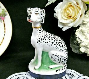 Staffordshire Dalmatian Dog Figurine With A Blue Base And Painted Design