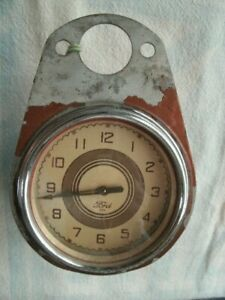 Ford Script Clock For Dash W Mounting Bracket Geo w Borg Corp Chicago