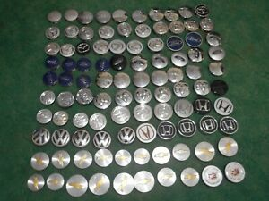 Lot Of 100 Small Wheel Center Caps Ford Chevy Mazda Jeep Toyota Cadillac Vw