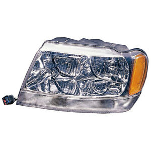 Omix Ada 12402 11 Left Headlight 99 04 Jeep Grand Cherokee Wj