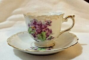 Vintage Ucagco Tea Cup And Saucer Gold Accents Purple Floral Footed Scalloped
