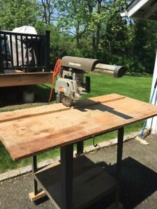 Black & Decker TR 1102 Type B 8 inch radial arm saw on stand with locking wheel