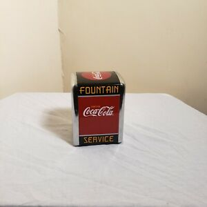 Vintage Coca Cola Napkin Dispenser Red Black and Yellow Colors.