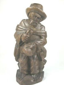 Hand Carved Wooden Figure Wandering Peasant Man Seated 6 5 Tall Dark Wood