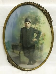 Antique Gold Plate Metal Oval Frame Convex Glass Hand Tinted Photo Boy Soldier