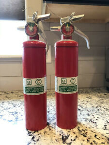 Halon 1211 Fire Extinguishers 2 1 2lbs selling Two One Needs To Be Recharged