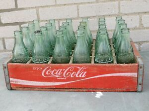 1970's COCA COLA WOOD CRATE + 24 PATT D BOTTLES WITH CITY'S ON BOTTOM