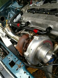Turbonetics T3t4 Bb Turbo Blox Style Manifold With Studs And 2 5 Downpipe