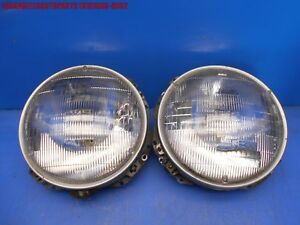 83 91 Porsche 944 Headlight Bulb Lamp W Trim Bezels And Bucket Bracket Retainer