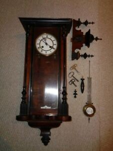 1900s Hand Carved Walnut Cherry Wall Clock Finials Greek Face Glass Door Hanging