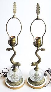 A Pair Of Vintage Brass Dolphin Form Lamps With Glass Fonts Rewired