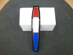 New 1965 Plymouth Sport Fury Red White Blue Grille Plastic Medallion