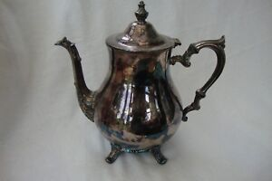 An Elegant Vintage English Silver Plated Teapot Standing On Four Raised Feet