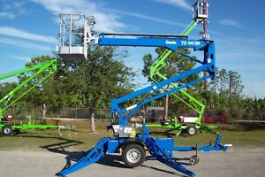 Genie Tz34 20 40 Towable Boom Lift good Batteries new Charger new Tires painted