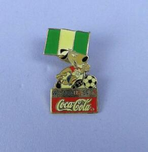 World Cup USA 1994 Coca Cola Pin Badge - Mascot With Nigerian Flag - Unused