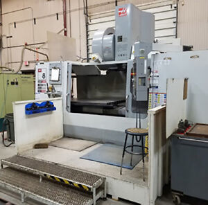Used Haas Vf8 Cat 50 Cnc 3 axis Vertical Machining Center W 4th Axis Attachment