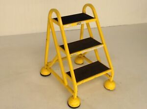 Uline H 969y 3 Step Yellow Steel Step Ladder Spring loaded Retract Casters 1029